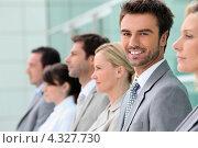 Купить «Деловые люди на фоне офисного здания», фото № 4327730, снято 15 июня 2010 г. (c) Phovoir Images / Фотобанк Лори
