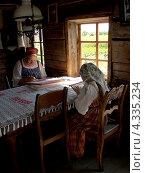 Купить «Бабушка и внучка в карельских народных костюмах занимаются вышивкой», эксклюзивное фото № 4335234, снято 11 июля 2012 г. (c) Ирина Борсученко / Фотобанк Лори
