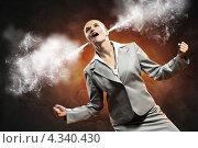 Купить «Деловая женщина с идущим из ушей дымом кричит от злости», фото № 4340430, снято 27 ноября 2012 г. (c) Sergey Nivens / Фотобанк Лори