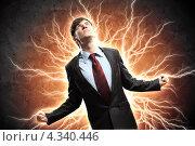 Купить «Бизнесмен в черном костюме среди электрических разрядов. Концепция стресса на работе», фото № 4340446, снято 27 ноября 2012 г. (c) Sergey Nivens / Фотобанк Лори