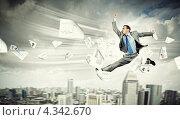 Купить «Молодой перспективный предприниматель в прыжке на фоне современного города среди летающих деловых бумаг», фото № 4342670, снято 16 декабря 2017 г. (c) Sergey Nivens / Фотобанк Лори