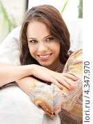 Купить «Счастливая красивая девушка отдыхает дома», фото № 4347970, снято 16 июля 2011 г. (c) Syda Productions / Фотобанк Лори