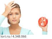 Купить «Расстроенная девушка с будильником в руке», фото № 4348066, снято 28 августа 2011 г. (c) Syda Productions / Фотобанк Лори