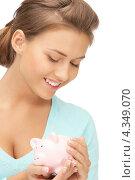 Купить «Счастливая девушка с розовой копилкой на белом фоне», фото № 4349070, снято 28 августа 2011 г. (c) Syda Productions / Фотобанк Лори