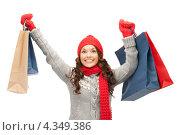 Купить «Красивая девушка на белом фоне держит в руках бумажные пакеты с покупками», фото № 4349386, снято 30 октября 2011 г. (c) Syda Productions / Фотобанк Лори