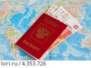 Купить «Российский заграничный паспорт с пятитысячными купюрами лежит на карте мира», эксклюзивное фото № 4353726, снято 28 февраля 2013 г. (c) Игорь Низов / Фотобанк Лори