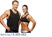 Купить «Спортивные мускулистые мужчина и женщина в черных майках», фото № 4369482, снято 31 июля 2011 г. (c) Andrejs Pidjass / Фотобанк Лори