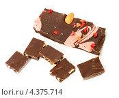 Купить «Шоколад с кусочками груши и орехами и шоколад с миндалем и малиной», фото № 4375714, снято 8 марта 2013 г. (c) Валерия Попова / Фотобанк Лори