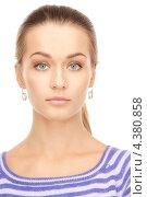 Купить «Стройная молодая женщина в бело-синей тельняшке с длинными рукавами», фото № 4380858, снято 10 октября 2010 г. (c) Syda Productions / Фотобанк Лори