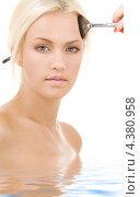 Купить «Красивая молодая блондинка стоит по шею в воде на белом фоне», фото № 4380958, снято 19 июля 2008 г. (c) Syda Productions / Фотобанк Лори
