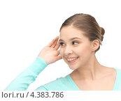 Купить «Любопытная девушка с интересом прислушивается к сплетням», фото № 4383786, снято 26 февраля 2012 г. (c) Syda Productions / Фотобанк Лори