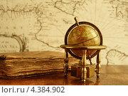 Купить «Глобус и старинная книга на столе на фоне карты», фото № 4384902, снято 6 апреля 2012 г. (c) Andrejs Pidjass / Фотобанк Лори