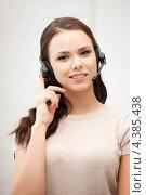 Купить «Счастливая молодая женщина из телефонной службы поддержки», фото № 4385438, снято 16 июля 2011 г. (c) Syda Productions / Фотобанк Лори