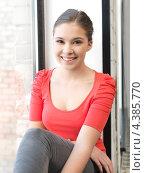 Купить «Девушка студентка у окна кабинета», фото № 4385770, снято 26 февраля 2012 г. (c) Syda Productions / Фотобанк Лори