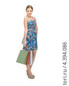 Купить «Счастливая молодая женщина с пакетами на белом фоне», фото № 4394086, снято 26 февраля 2012 г. (c) Syda Productions / Фотобанк Лори