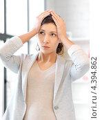 Купить «Уставшая молодая женщина с головной болью», фото № 4394862, снято 31 марта 2012 г. (c) Syda Productions / Фотобанк Лори