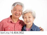 Двое пожилых людей китайской внешности. Стоковое фото, фотограф Monkey Business Images / Фотобанк Лори