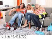 Купить «Три подруги отдыхают после уборки квартиры», фото № 4419730, снято 1 июля 2010 г. (c) Phovoir Images / Фотобанк Лори