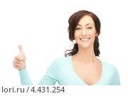 Купить «Красивая молодая женщина с поднятым большим пальцем на руке показывает, что все хорошо», фото № 4431254, снято 16 октября 2011 г. (c) Syda Productions / Фотобанк Лори