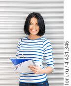 Купить «Очаровательная студентка с темными волосами в голубой тельняшке», фото № 4431346, снято 7 апреля 2012 г. (c) Syda Productions / Фотобанк Лори
