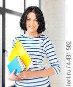 Купить «Очаровательная студентка с темными волосами в голубой тельняшке», фото № 4431502, снято 7 апреля 2012 г. (c) Syda Productions / Фотобанк Лори