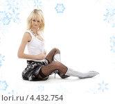 Купить «Привлекательная блондинка в черных чулках в сапогах на каблуках на белом фоне со снежинками», фото № 4432754, снято 27 октября 2007 г. (c) Syda Productions / Фотобанк Лори