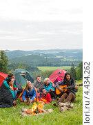 Купить «Друзья с гитарой у костра», фото № 4434262, снято 11 августа 2012 г. (c) CandyBox Images / Фотобанк Лори