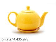 Желтый заварочный чайник. Стоковое фото, фотограф CHERKAUSKAS VIKTOR / Фотобанк Лори