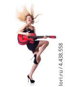 Купить «Радостная блондинка играет на красной гитаре», фото № 4438558, снято 5 января 2013 г. (c) Elnur / Фотобанк Лори