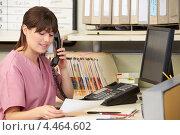 Купить «Медсестра разговаривает по телефону в регистратуре», фото № 4464602, снято 21 октября 2012 г. (c) Monkey Business Images / Фотобанк Лори