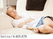 Купить «Милая юная девушка дремлет на диване дома», фото № 4465878, снято 6 августа 2020 г. (c) Syda Productions / Фотобанк Лори