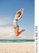 Купить «Счастливая девушка в голубом бикини прыгает на пляже под ясным небом», фото № 4466918, снято 21 июля 2012 г. (c) Syda Productions / Фотобанк Лори