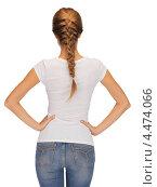 Купить «Стройная девушка в белой футболке стоит спиной», фото № 4474066, снято 16 сентября 2012 г. (c) Syda Productions / Фотобанк Лори