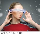 Купить «Молодая женщина в цифровых очках», фото № 4474110, снято 17 ноября 2012 г. (c) Syda Productions / Фотобанк Лори