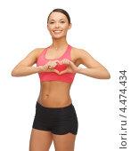 Купить «Молодая спортивная женщина занимается физкультурой», фото № 4474434, снято 12 января 2013 г. (c) Syda Productions / Фотобанк Лори