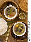 Купить «Китайский суп с рисом на деревянной поверхности с соусом из чили и уксуса», фото № 4481654, снято 6 апреля 2013 г. (c) Eve Voevoda / Фотобанк Лори