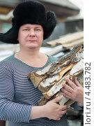 Купить «Мужчина в зимней шапке у деревенского дома с дровами в руках», фото № 4483782, снято 6 апреля 2013 г. (c) Типляшина Евгения / Фотобанк Лори