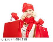 Купить «Радостная девушка с покупками после удачного похода по магазинам», фото № 4484198, снято 2 октября 2011 г. (c) Syda Productions / Фотобанк Лори
