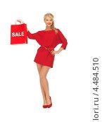 Купить «Соблазнительная девушка в платье с красным знаком со словом скидка», фото № 4484510, снято 7 октября 2012 г. (c) Syda Productions / Фотобанк Лори