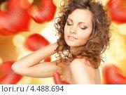 Купить «Красивая молодая женщина на праздничном фоне с сердечками», фото № 4488694, снято 27 июня 2019 г. (c) Syda Productions / Фотобанк Лори