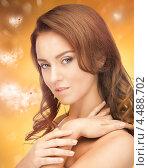 Купить «Красивая молодая женщина на праздничном фоне с сердечками», фото № 4488702, снято 14 ноября 2019 г. (c) Syda Productions / Фотобанк Лори