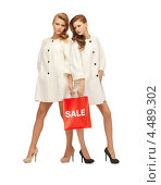 Купить «Две красивые молодые женщины с длинными волосами в светлых плащах на белом фоне», фото № 4489302, снято 28 октября 2012 г. (c) Syda Productions / Фотобанк Лори