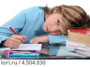 Купить «Уставший мальчик делает домашнее задание», фото № 4504830, снято 21 декабря 2010 г. (c) Phovoir Images / Фотобанк Лори