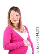 Счастливая беременная женщина придерживает рукой живот и смотрит на камеру, белый фон. Стоковое фото, фотограф Losevsky Pavel / Фотобанк Лори