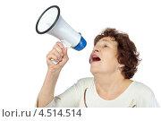 Купить «Пожилая женщина кричит что-то в мегафон», фото № 4514514, снято 17 ноября 2011 г. (c) Losevsky Pavel / Фотобанк Лори