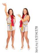 Купить «Две счастливые женщины-близняшки в шортах, белый фон», фото № 4514578, снято 25 мая 2011 г. (c) Losevsky Pavel / Фотобанк Лори