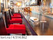 Купить «Красные стулья около барной стойки в суши-ресторане», фото № 4514862, снято 26 мая 2011 г. (c) Losevsky Pavel / Фотобанк Лори