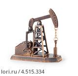 Купить «Металлический сувенир в виде нефтяного насоса-качалки», фото № 4515334, снято 23 октября 2011 г. (c) Losevsky Pavel / Фотобанк Лори