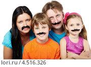 Портрет семьи с приклеенными черными усами. Стоковое фото, фотограф Losevsky Pavel / Фотобанк Лори