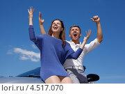 Купить «Веселая молодая пара радуется, подняв руки вверх. Мужчина и девушка стоят около серебристого кабриолета», фото № 4517070, снято 12 июня 2011 г. (c) Losevsky Pavel / Фотобанк Лори